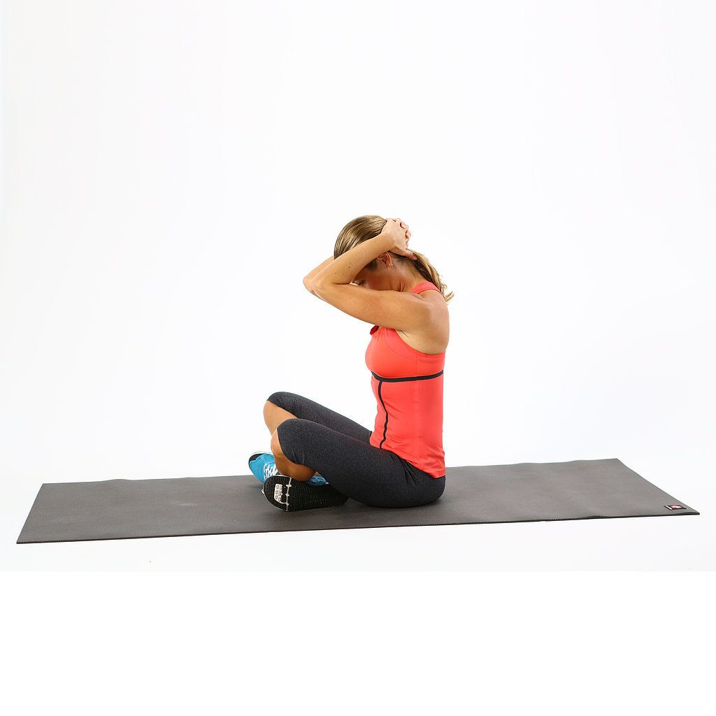 A woman performing a exercise called the seated clasping neck stretch