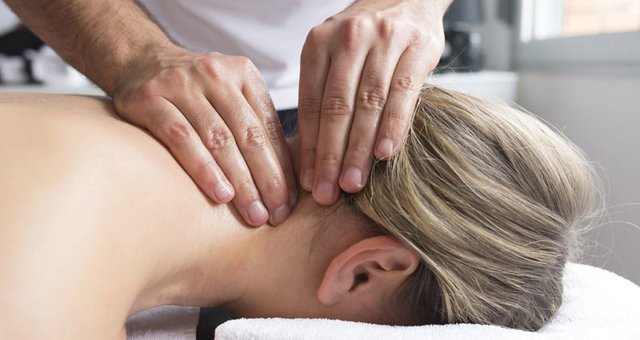 A woman receiving a soothing neck massage