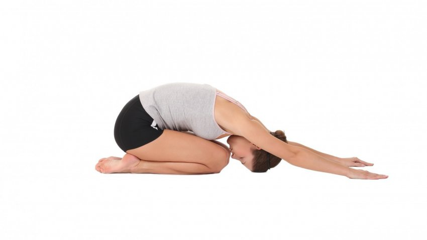 Women doing in a childs pose on the ground