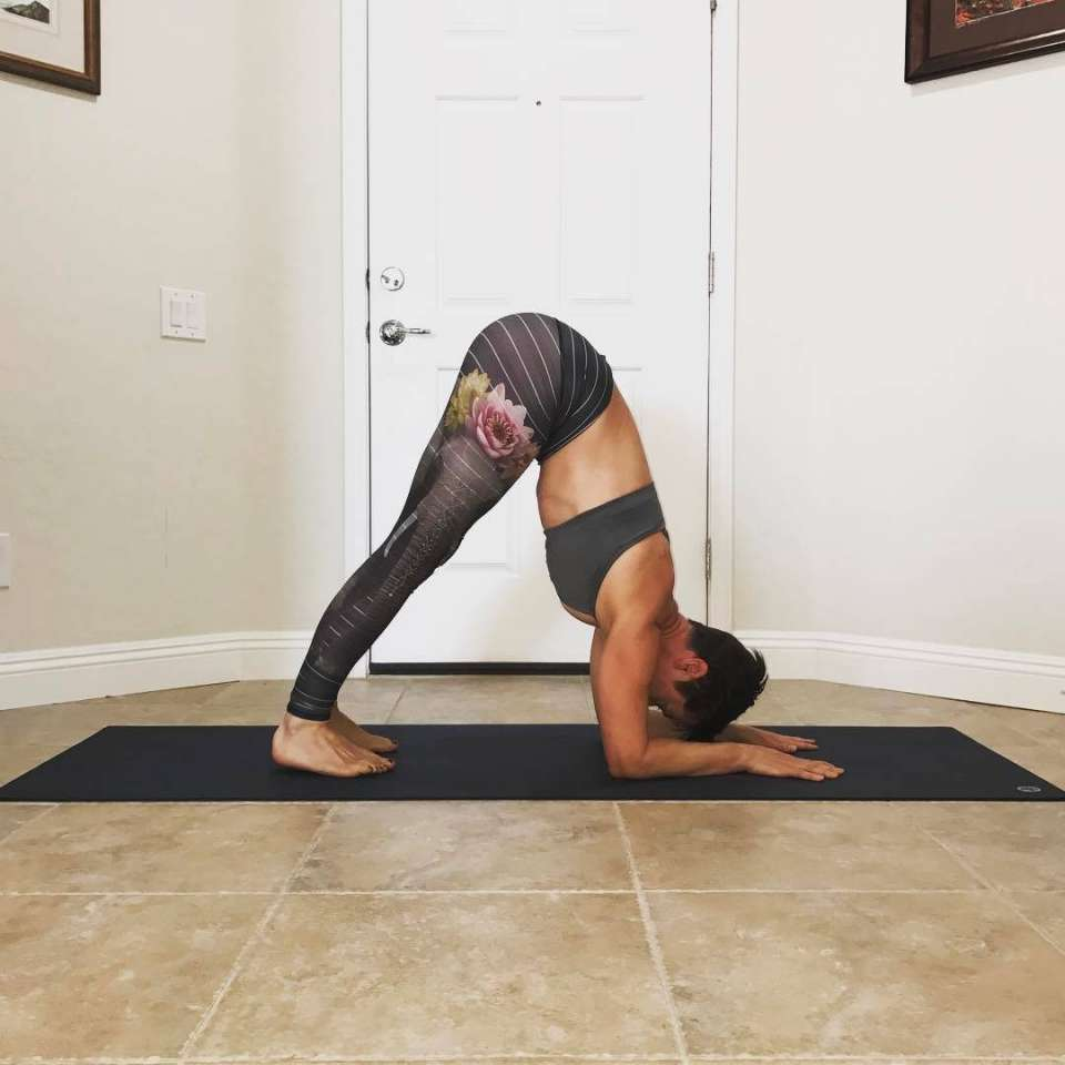 A woman in a dolphin pose