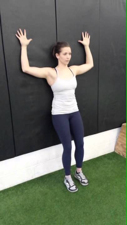 Women against the wall in Yoga Pose