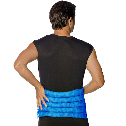 A man with his back turned showing his back covered by a heat pack which most of his lower back is covered