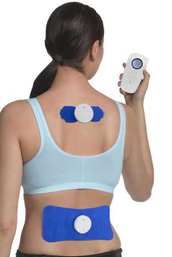 Woman using a Tens Machine to reduce pain in her shoulders and lower back